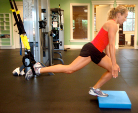 Marie demonstrating TRX Suspension